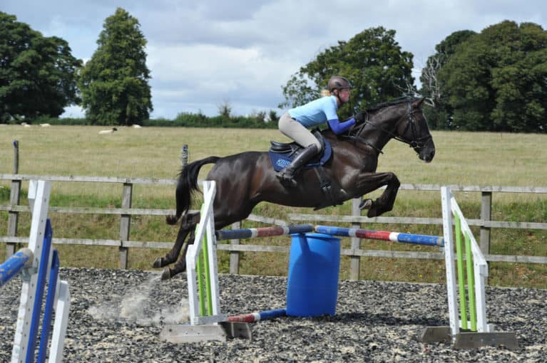 Izzy Taylor teaching rider how to jump XC corners
