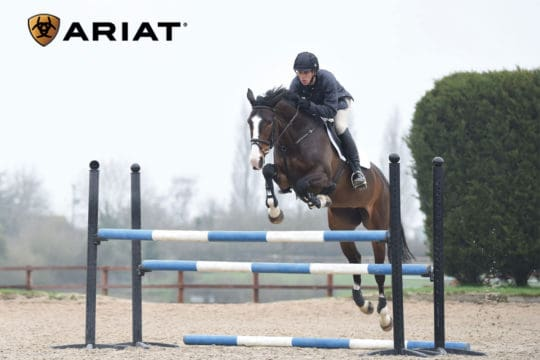 Nick Gauntlett jumping an oxer fence, with thanks to Ariat for their help