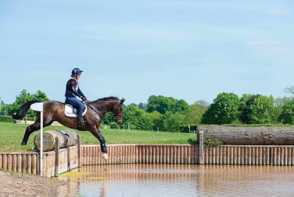 Tina Cook jumping into water