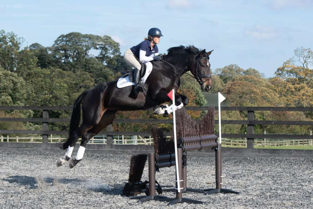 Ros Canter jumping a skinny fence