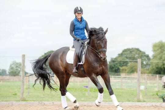 Sophie Wells riding an exercise to engage horse