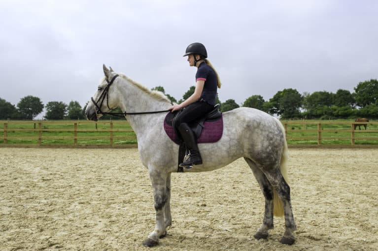 Slouching while riding a horse