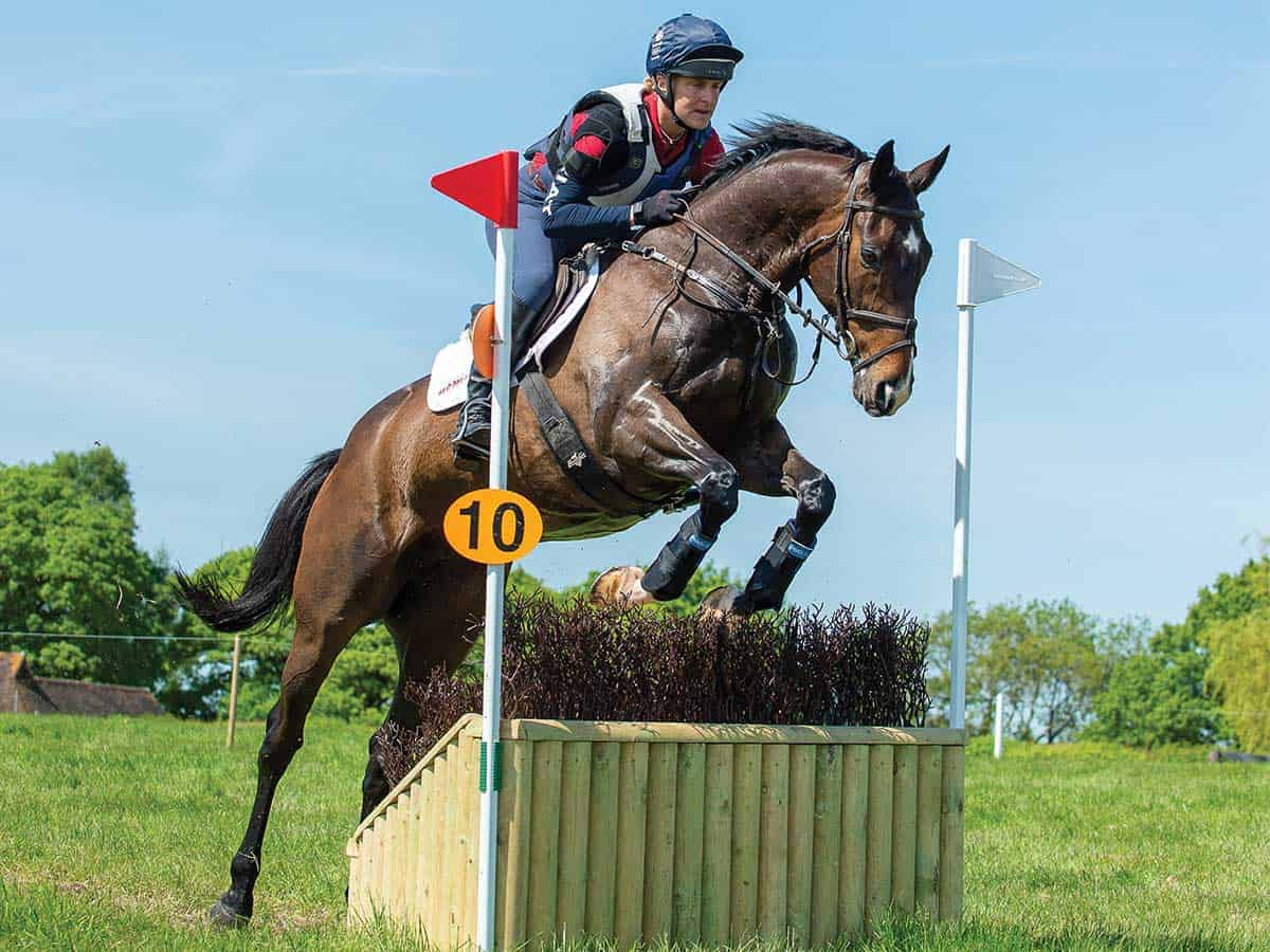 Tina Cook jumping a narrow cross-country fence