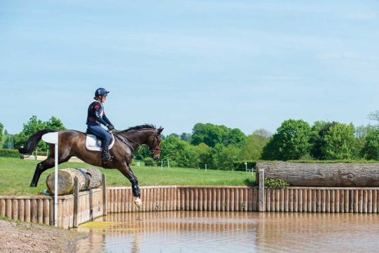 Tina Cook jumping in to a water jump