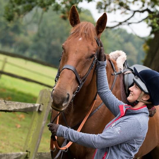 Rider patting horse