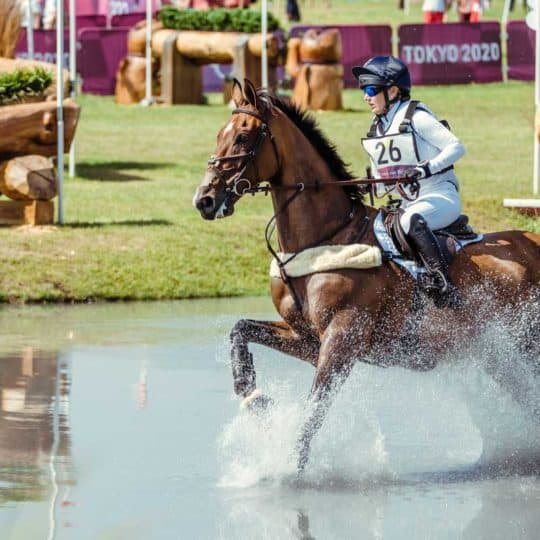Laura Collett and London 52 storm the cross-country to finish within the time, going into the showjumping in provisional bronze medal position